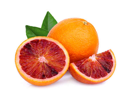 whole and slices blood orange with green leaf isolated on white background Imagens