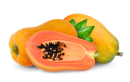 two whole and half ripe papaya fruit with green leaves isolated on white background Фото со стока