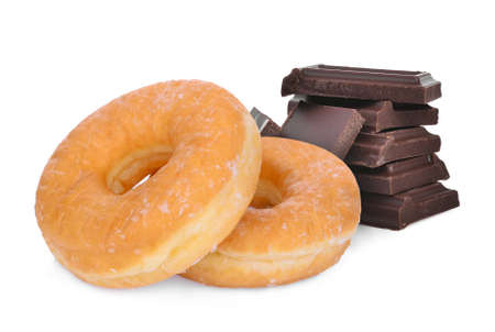 donut and dark chocolate bars isolated on a white background