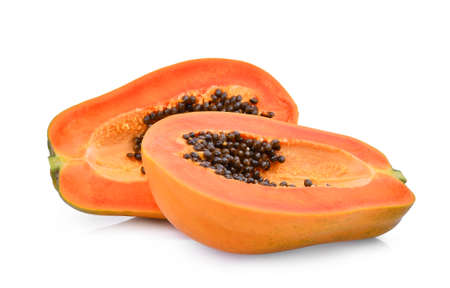 half of ripe papaya fruit with seeds isolated on white background