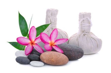 stones, frangipani flower, spa herbal compressing ball, bamboo leaf isolated on white background, spa concept