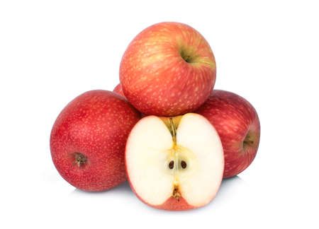 whole and half pink lady apple isolated on white background