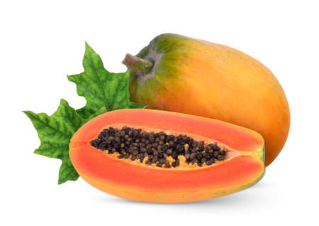 whole and half of ripe papaya fruit with green leaves isolated on white background
