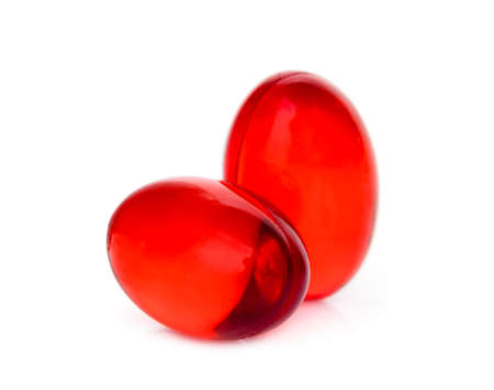 two red soft gel capsule isolated on white background Banque d'images - 143280680