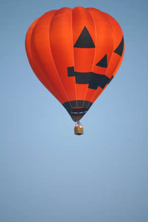 Halloween Bolloon orange color in the air photo