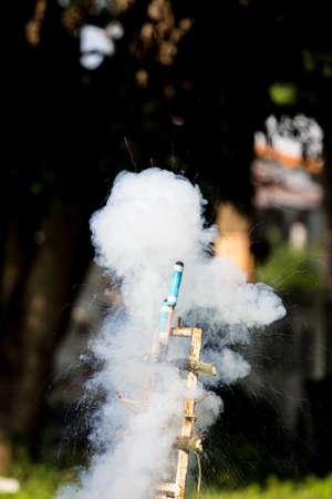 homemade rocket launching. gunpowder powered. sparking and smoking