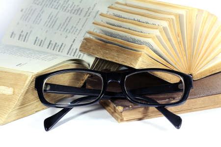 old book and eyeglasses photo