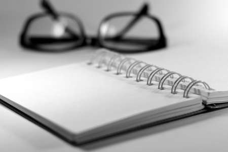 Notebook with eyes glasses photo
