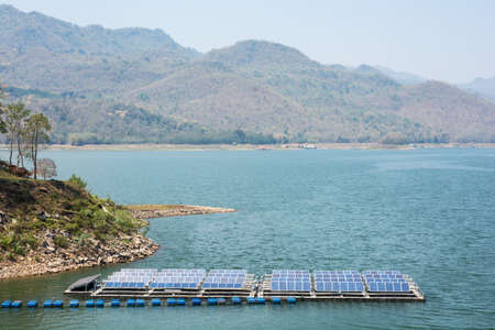 enormously: Advanced manufacturing technology they work with electricity. Solar panels placed on the river Stock Photo