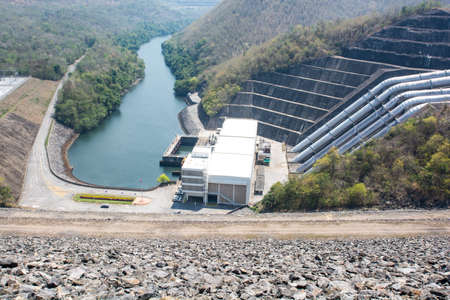 generating station: Generating station with a stream of water from the dam. Stock Photo