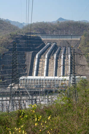 dams: Load power plant of large dams on the river vertical view. Stock Photo