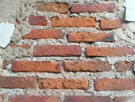 brick road: grunge background, red brick wall texture bright plaster wall and blocks road sidewalk abandoned exterior urban background for your concept or project Stock Photo