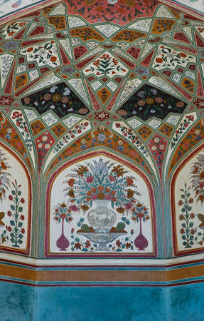 Flora decorative on wall in Amber fort, India