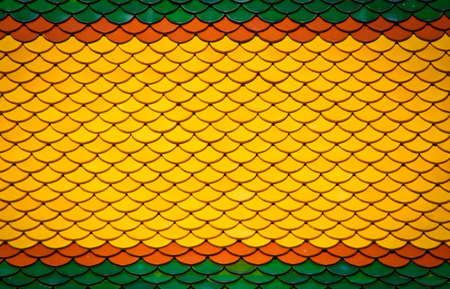 Colorful ceramic tile pattern on Thai temple roof photo