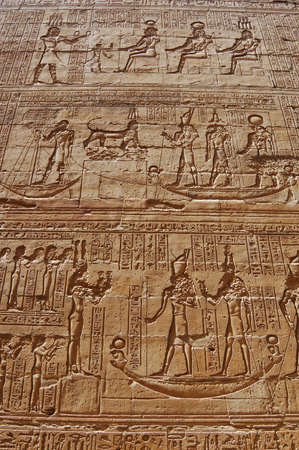 Egyptian carving on wall in Edfu temple, Egypt photo