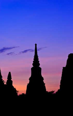 Silhouette Thai pagoda at sunset, Ayutthaya, Thailand photo