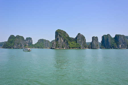Limestone mountains in Halong bay, Vietnam photo