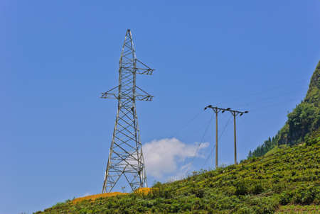 Unfinished electricity pylon on mountain photo