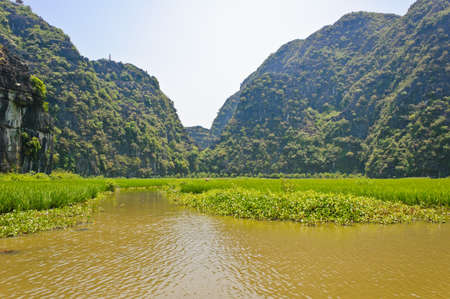 Landscape of limestone mountains at Tam Coc in Ninh Binh, Vietnam photo