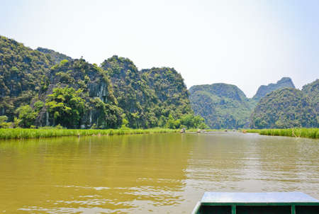 Scenic of limestone mountains along river, Vietnam photo
