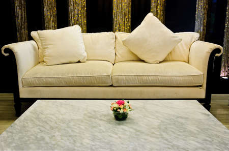 Fabric sofa and marble table in living room photo
