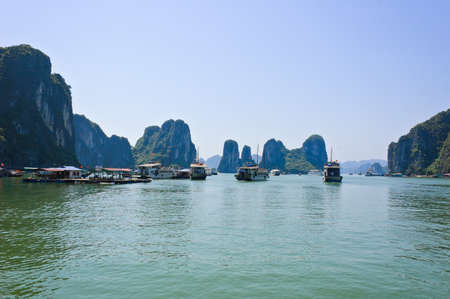 Tourist boats at floating fishing village in Halong bay, Vietnam