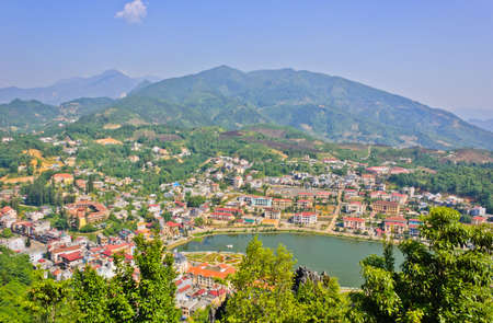 Sapa lake and town in green valley, Vietnam photo