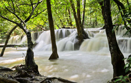 Waterfall stream in tropical rain forest, Thailand photo