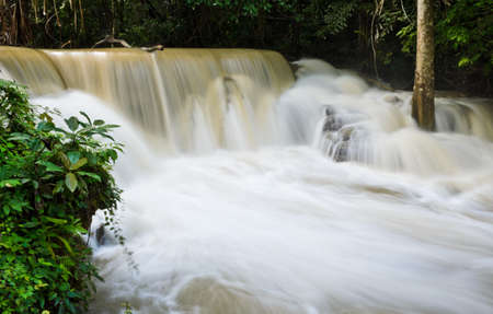 Waterfall in tropical rainforest, Thailand photo