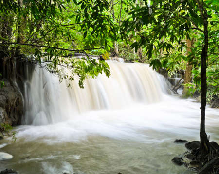 Tropical rainforest waterfall, Thailand photo