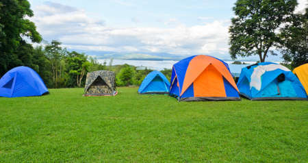 Camping tents on the mountain photo
