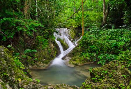 Landscape with waterfall in tropical rain forest, Thailand Stock Photo