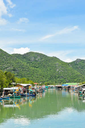 Fishing village against limestone mountain, Thailand photo