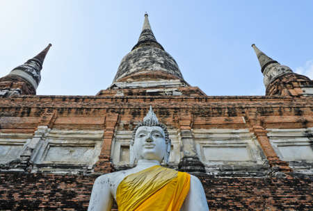 Pagoda and Buddha Statue at Wat Yai Chaimongkol, Ayutthaya, Thailand photo