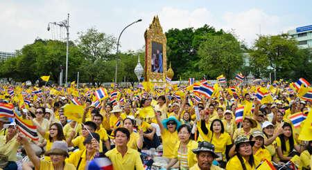 harmonize: BANGKOK, THAILAND - DECEMBER 5  Thai people wave flags during King Bhumibol speech on his 85 th birthday celebration on December 5, 2012 in Bangkok, Thailand