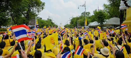 BANGKOK, THAILAND - DECEMBER 5  Thai people wave flags during King Bhumibol speech on his 85 th birthday celebration on December 5, 2012 in Bangkok, Thailand   Stock Photo - 16781756