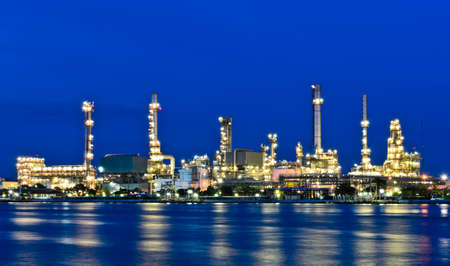 Oil refinery plant illuminated at dusk photo