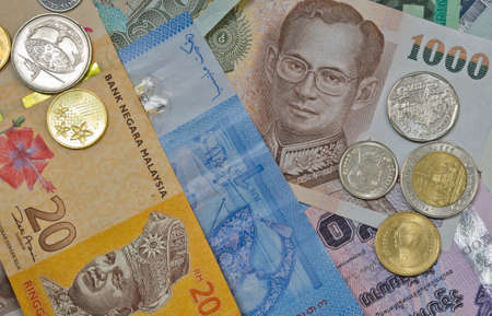Background of Malaysian and Thai currency photo