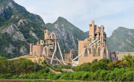 Cement plant with limestone mountain  photo