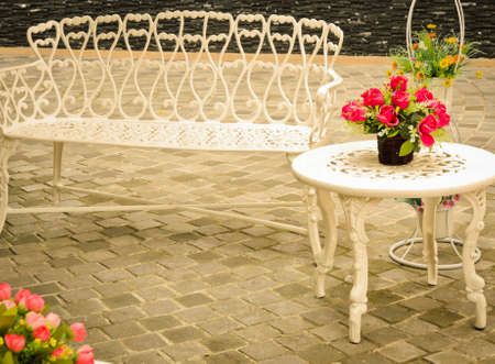 Outdoor vintage table and bench photo