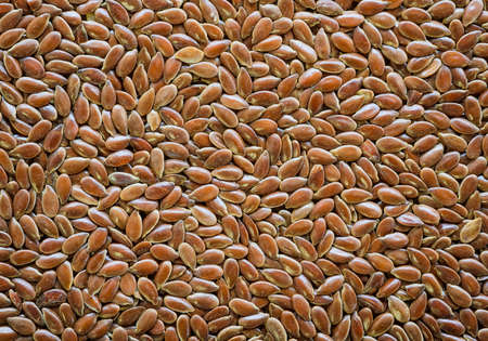 Brown flax seed background photo