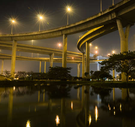 Architecture of Bhumibol bridge at night in Bangkok, Thailand photo