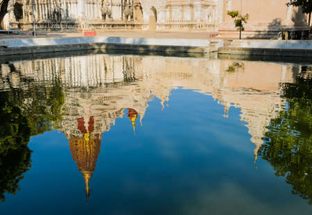 Reflection of Ananda temple in pond,   Bagan, Myanmar photo