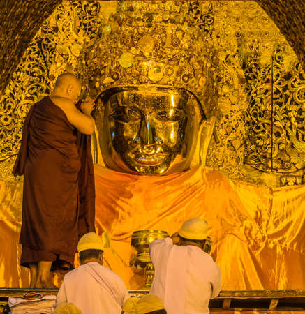 The ritual of daily face washing Mahamuni Buddha in Mandalay, Myanmar Stock Photo - 25655729