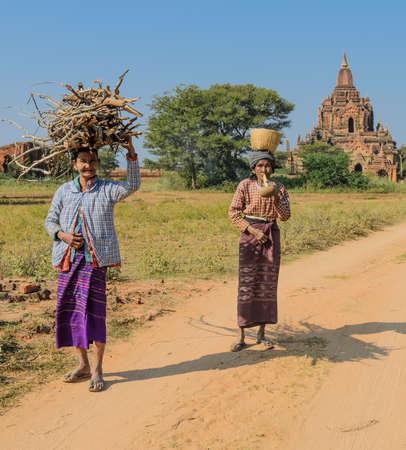 cheroot: Unidentified Burmese women on the road in Bagan, Myanmar Editorial