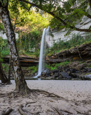 Deep forest waterfall with sand beach in Ubon Ratchathani, Thailand photo
