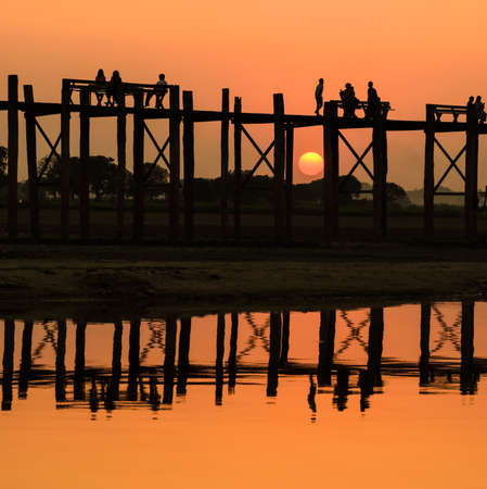 U Bein bridge at sunset in Amarapura , Myanmar photo