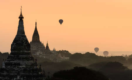 Bagan at sunrise with hot air balloon, Myanmar  photo