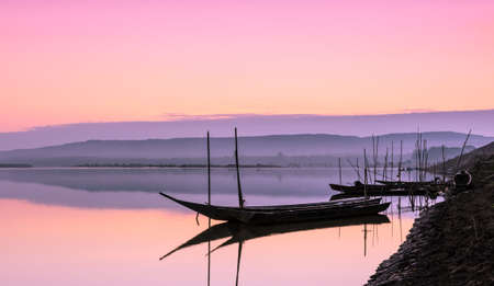 Pink sunrise over the river photo
