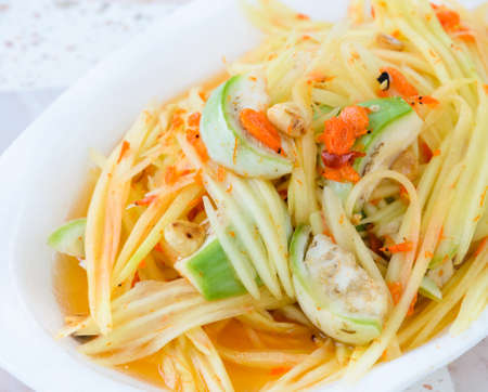 Thai green papaya salad also known as Som Tum photo